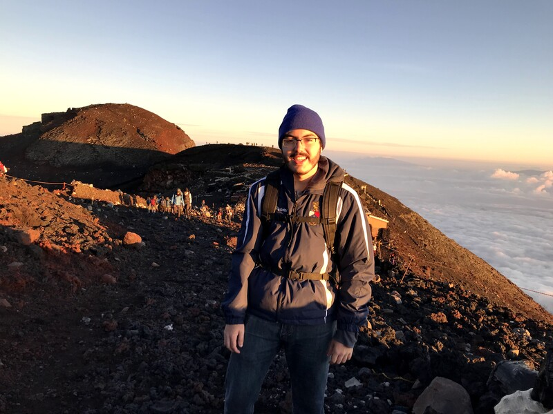A photo of Joseph Petitti at the summit of Mount Fuji